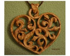 Fantastic heart pendant by the artist Erlion from Etsy  made from siberian birch