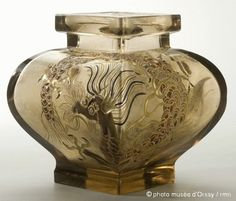 ❤ - Émile Gallé   Emile Gallé and glassware Meisenthal Pot decorated with dragon, circa 1880. Smoked glass, enamel (enamel in relief) - Museé d'Orsay.