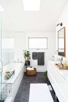 Modern bathroom renovation -- white subway tile and darker grout Laundry In Bathroom, Bathroom Renos, Bathroom Flooring, Bathroom Renovations, Bathroom Interior, Bathroom Grey, Bathroom Goals, White Bathrooms, Dark Floor Bathroom