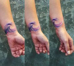 Watercolor style wave tattoo on the left wrist. Done by Simona Blanar