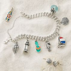 Surf's up and beach charms are in! Whether it's a gift or reminder of a memorable vacation, these charms will warm the heart all year long. #JamesAvery