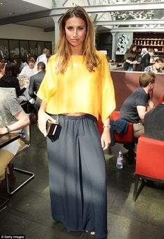 Yellow was the order of the day: TOWIE's Ferne McCann wears the summery hue for the launch...
