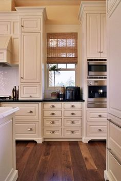 Traditional Kitchen with Carrara marble, Large Ceramic Tile, Custom hood, Cup pull hardware, High ceiling, Raised panel