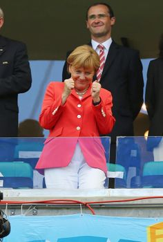 German Chancellor Angela Merkel, one of the most powerful women on earth, looks on from the stands during the 2014 FIFA World Cup Brazil Group G match between Germany and Portugal. She is one of the biggest fans of the German soccer team. World Cup 2014, Fifa World Cup, Germany Soccer Team, Champion, Donald Trump Jr, Power Dressing, Soccer Fans, World Leaders, Powerful Women