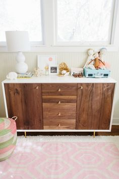 Taylor Sterling's Nursery/Office Makeover | theglitterguide.com, pink nursery, modern dresser/changing table