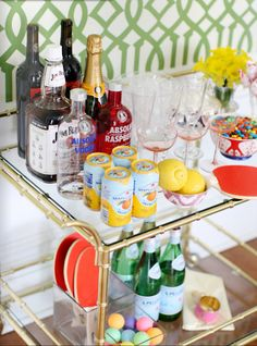 Love the playfulness of this bar cart, with the M's and paddle tennis.