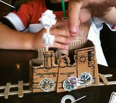 A train, made in 15 minutes completely out of a coffee cup insulator and wooden stir sticks. This would keep my 4 year old entertained for hours at a coffee shop. Diy Crafts For Kids, Fun Crafts, Recycle Crafts, Craft Ideas, Repurpose, Decor Ideas, Coffee Cup Sleeves, Business For Kids, Coffee Cups