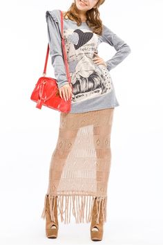 This skirt crafted in cotton, featuring cut-out design to the main, tassels hemline, designed with an ankle length cut.$75