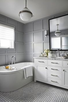 Cameron MacNeil Designer: Gray modern bathroom with gray walls paint color, freestanding tub, marble basketweave ...