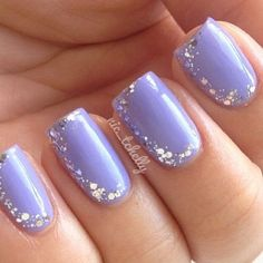 Pretty looking half nail glitter nail art design combined with a periwinkle base coat.
