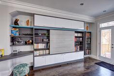 Family room built-in in Antracita, with High-Gloss White and River Rock doors, and factory-painted accent shelf. Photo by Aaron Mason.