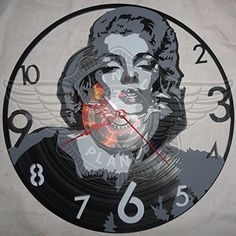 VINYL WALL CLOCK MARILYN MONROE 2 VINYL PLANET https://www.amazon.ca/dp/B01LXERPKE/ref=cm_sw_r_pi_dp_x_51YhAbY7FSS9Y