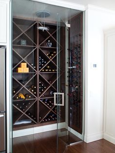 Walk-In Wine Cellar   Products:    Millwork, Guy Roy, Aux Bois d'Oeuvres.  Designer: Scott Yetman Design