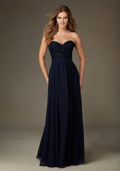 Beaded Lace Bridesmaid Dress with a Sweetheart Neckline Designed by Madeline Gardner. Shown in Navy.