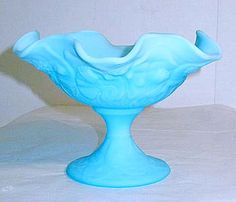 This is a very pretty Fenton blue satin compote in the waterlily pattern. It stands 5 inches high and is inches across. This compote is in nice condition with no chips or cracks. Fenton Glassware, Vintage Glassware, Vaseline Glass, Opaline, Carnival Glass, Blue Satin, Glass Collection, Antique Glass, Milk Glass