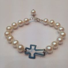Pulsera en perlas y plata para niña