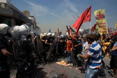 Riot police clash with a crowd during a demonstration near Taksim Square on June 11, 2013
