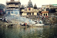 """Burning Ghat, Varanasi India.  As used in many parts of South Asia, the term ghat (Bengali: ঘাট, Hindi: घाट ghāṭ """"steps"""") refers to a series of steps leading down to a water body, usually a holy river. In Bengali-speaking regions, this set of stairs can lead down to something as small as a pond or as large as a major river."""