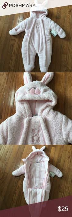 Brand New Bunny Snowsuit light pink and precious Brand new w tag ultra soft and warm snow suit for baby..complete w bunny ears and cute tail in the back! Sherpa on the outside and completely lined w fleece inside..two side zippers and velcro attachment at chest..baby bunny will def stay warm in this!! Bebe d' Amour Jackets & Coats