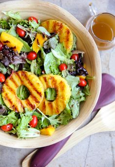 Grilled Tropical Summer Salad:   Pineapple holds up well over the coals, and a grilled pineapple makes for a sensational salad.