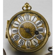 TURET A GILT BRASS VERGE WATCH LATE 17TH/EARLY 18TH CENTURY full plate gilt verge movement signed, pierced and engraved balance bridge, steel three arm balance wheel, fusee and chain, cast dial with enamel cartouche for Roman numerals and Arabic minutes, winding through the dial, associated case, case back opening to reveal the balance bridge through a glazed aperture, case with floral engravings diameter 56mm.