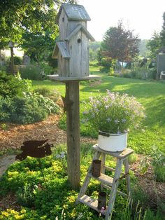 love this farm style setting with birdhouse......