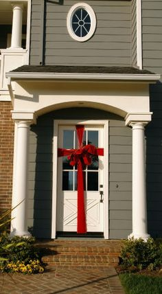 Wrap your door with a giant bow.  Quick, cheap, and easy way to decorate for the holidays (or even a shower or birthday party).