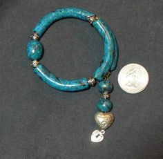 Faux turquoise polymer clay bracelet, formed on memory wire.