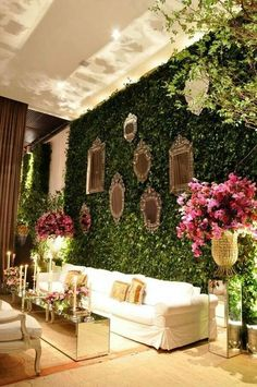 mirrors on greens with flowers.  where on earth would we put this/flower wall at the st regis?