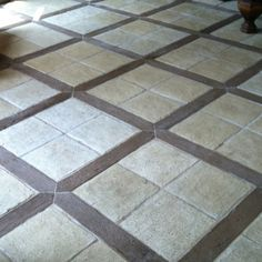 Concrete tiles with wood grain pickets. There are even warming mats underneath!