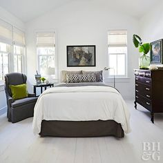Ground an all-white space with black accents for a contemporary look. This all-white bedroom idea (floors walls and ceiling) enlists the help of a charcoal bed skirt and dark wood furniture to ground the decor. Ground an all-white White Bedroom Dark Furniture, All White Bedroom, Dark Wood Furniture, Bedroom Furniture Sets, Modern Bedroom, Furniture Decor, Furniture Design, Bedroom Decor, White Bedding