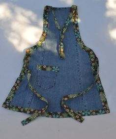 Cute upcycled jeans apron featuring adorable flowered fabric accents. $15.00, via Etsy.