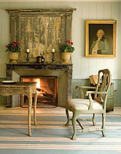 The family room of a Houston home in Swedish style, by Carol Glasser and Katrin Cargill.  Photo by Karyn R. Millet.  The painting reminds me of George Washington.  :-)