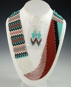 """-- INQUIRE -- ITEM NUMBER: NEC8925 ARTIST: Rena Charles TRIBE: Navajo DIMENSIONS: Measures 32"""" long and 1-1/2"""" Wide MORE DETAILS: Eye-catching Navajo Beade"""
