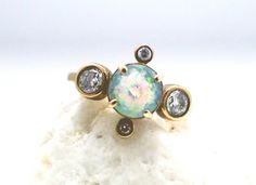 Stunning 14K yellow gold ring with faceted opal and your choice of white  diamonds or white sapphire.