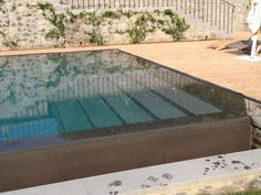 Téléchargez le catalogue et demandez les prix de Piscine à débordement By indalo piscine, piscine à débordement avec cascade