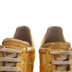 Maison Martin Margiela Gold leaf sneakers £380  Shop now at WWW.HERVIA.COM