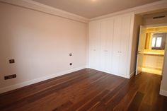 Dormitorio en Suite con carpintería en laca blanca