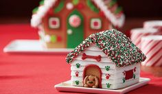 Decorate this gingerbread doghouse to add some puppy love to your gingerbread scene! The kit includes icing, dog bone sprinkles and a ready-made icing decoration dog. This kit is a fun activity to add to your holiday gingerbread house making. Here are 4 configurations of the same dog house. The first, The Pup Hut, is