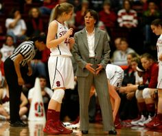 Stanford Cardinal head coach Tara VanDerveer talks to Stanford Cardinal's Karlie Samuelson (44) during a time-out vs Cal