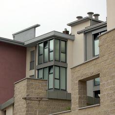 Fabrizio Curtabbi, Paolo Sanna — Edificio residenziale e commerciale