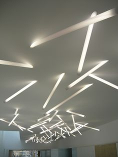 The Polycarb Stick Light is a T5 fluorescent light fixture consisting primarily of an illuminated tube that penetrates a ceiling cavity at an angle