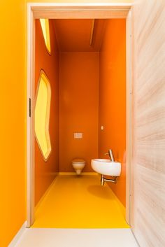 Kindergarden in Chroscice (Poland) designed by PORT | Orange toilets