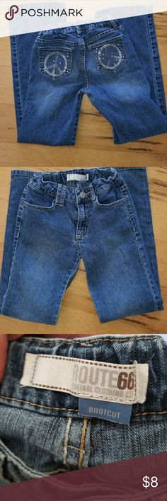 Route 66 jeans Girls bootcut jeans in good condition. Cute glitter and silver peace signs in back pockets. Route 66 Bottoms Jeans