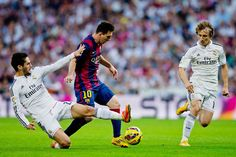 Isco of Real Madrid CF tackles Lionel Messi of Barcelona during the La Liga  match between a39a398d91225