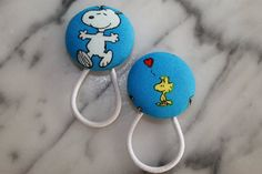 Snoopy and Woodstock pony tail holders make adorable party favors by Baby Raindrops, $5.95.