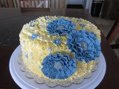 Buttercream ruffle cake with hand sculpted sugar flowers.