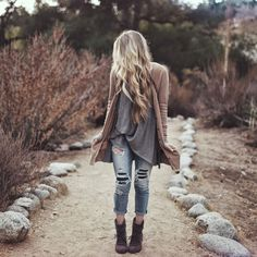 loose trendy look with denim and loose fitting clothing over some boots for the cold winter seasons: