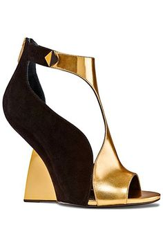 these black and gold heeless sergio rossie wedges from #ss14 are stunning. #shoeporn