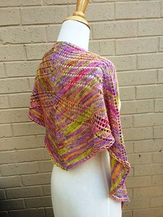 Knitted from the top down, Penelope is a long shawl with a curved top edge. You can wrap this shawl around your neck and shoulders and be both warm and stylish. Penelope can be knit until you run out of yarn and so this pattern will make best use of a lovely skein of multi-coloured yarn.